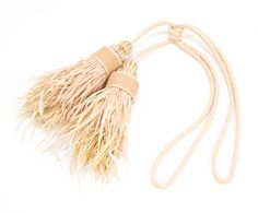 UNFINISHED LUXE RUSSIAN SILK TIEBACK Beautifully crafted with the finest silk, suede and raffia ribbon bobbles with a hessian and ribbon central band detail and stripped goose and coque feather fringe