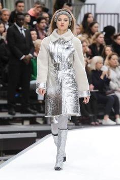 In Karl Lagerfeld's vision of space, women only wear black, ivory and silver with hits of soft pink and maybe some denim. If silver leather and shearling jackets and above-the-knee shorts, paired with black toe-capped silver gogo boots, are his version of Martian R&R gear, sign us up.