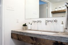 "Fixer Upper's Best Bathroom Flips | HGTV Love the faucets.  Good way to get ""two"" sinks in the space of one large one."