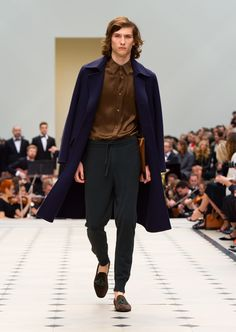 Ink blue double-faced wool topcoat, textured leather document case in bright toffee and ebony suede loafers with green tassels. Discover the collection at Burberry.com