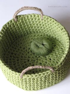 Crocheted t-shirt yarn basket with hemp string handles http://www.ravelry.com/projects/Bottheka/big-green-basket