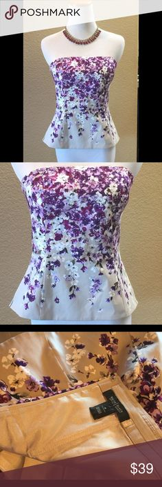 WHITE HOUSE BLACK MARKET TOP Truly beautiful strapless floral top with back zip closure. A goldish tan background with vibrant lavender and purple/Burgundy flowers. A bit of a flare at the waist. Was worn with a deep burgundy long Tulle skirt for a wedding. Dress down and wear with a casual skirt or pants. Add a little waist length jacket or sweater for a more demure look. Worn once. White House Black Market Tops