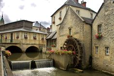 Bayeux, Normandy, France. I have my own photograph of this water wheel, taken before the digital age.