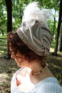 Day 8: velvet turban with feather (not brown, nor with a bronze green turban, but it looks good).