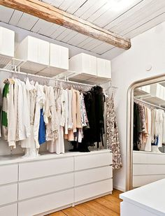 ikea malm and hanging shelves for a simple and stylish walk in closet