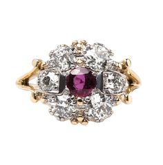 Redlands is a bold vintage ring featuring a 0.37ct ruby surrounded by diamonds! // $4,900