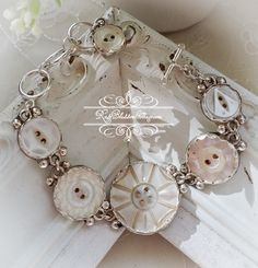 Antique Mother of Pearl  Carved Cross Button Bracelet I really like the little balls or beads soldered to the bezels.