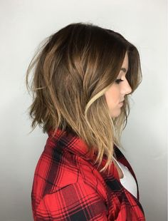 Colour accentuate this concave bob! Invisible layering throughout crests easy to style texture.