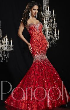 The sweetheart strapless mermaid bodice and full skirt are made of sequined embroidered lace, and he gown is covered at the bust line and thighs with glittering AB stones. Sequin Embroidered Lace