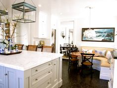 Lighting, banquette, beadboard ceiling, and cabinetry