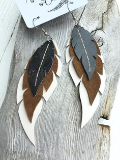 Items similar to Layered Leather Feather Earrings- Owl feathers on Etsy - - Items similar to Layered Leather Feather Earrings- Owl feathers on Etsy Polymer clay Diy Leather Earrings, Leather Jewelry, Leather Craft, Handmade Leather, Feather Earrings, Dangly Earrings, Diy Earrings With Feathers, Owl Earrings, Etsy Earrings