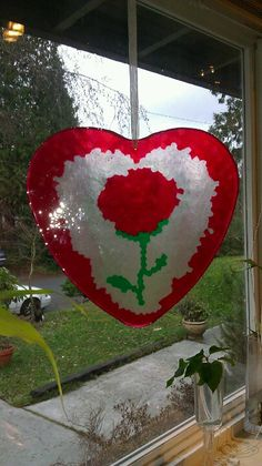 My boyfriend and I just made this Valentine's day heart DIY out of melted plastic beads 400 degree oven for 20 min on heart mold for cookies Pop Top Crafts, Tin Can Crafts, Fun Crafts, Crafts For Kids, Melted Bead Crafts, Pony Bead Crafts, Easter Crafts, Christmas Crafts, Melted Pony Beads