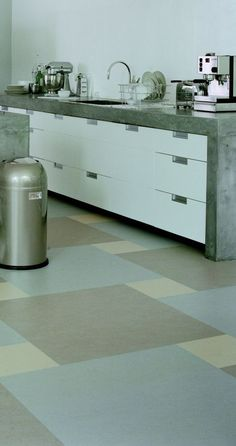concrete worktops and cool floor colours