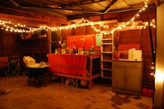 another shot of the garage bar with twinkle lights that @Pamela Smith and Luke Plonsky created for their going away party. The wheelbarrow is full of ice and there were cold drinks there. I miss them.