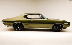 1968 Pontiac GTO. Side note, we think cars can still look tough without rolling on big wheels... good on ya
