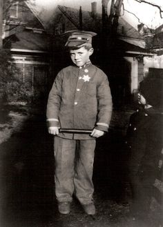 JFK Playing policeman, about age five.