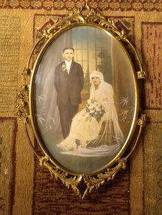 antique large wedding picture under convex glass with damaged brass frame. $60.00, via Etsy.