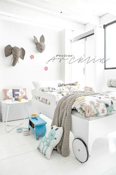 Bright, white and playful kids room with hints of soft colour