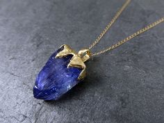 Hey, I found this really awesome Etsy listing at https://www.etsy.com/listing/226029830/raw-tanzanite-crystal-gold-pendant-rough