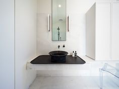 This beautifully designed/ renovated home in Middle Park brings the traditional Edwardian house to the modern day. Our Branco Vena Marble is the main material used on all floors, walls and bench tops of the main bathroom and ensuite. All the natural characteristics of the stone allows the space to have a light and floaty feel from its minimal and neutral colour tones. Branco Vena is also featured at the base of all fireplaces throughout the house. Edwardian House, Bathroom Inspiration, Neutral Colors, Double Vanity, Natural Stones, Sink, Flooring, Fireplaces, Modern