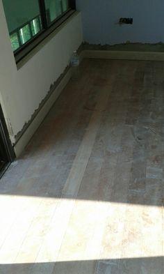 Solid wood merbau floor next to tile floor. Before grind & polish ...