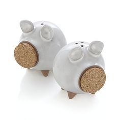 Shop Pig Salt and Pepper Shakers.  Cork lids provide the snouts for our whimsical pig-shaped salt and pepper shakers.  Molded with liquid clay, each piece is dipped in a translucent white glaze.