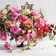 Arrangement by Ariella Chezar    'La Belle Epoch' Tulips, Fuchsia Tree Peonies, White 'Shooting Star' Hydrangeas, Plum Tree Foliage, Eucalyptus Berries and Clematis Montana