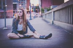 Miranda. Miranda and I explored the city and took pictures. We went for an edgy, grunge look for these portraits. Taken on Morris Avenue in Birmingham, Alabama.