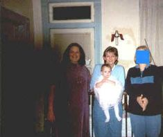 """SHADOW ENTITY ENTERS ROOM! Deb writes """" the following are Easter pictures that I just got back from the developers. These photos were pic numbers 3 and 4 on a roll of 27 and the camera was a disposable, strapless, 35mm. The black shadow is on the negative of photo number four. My daughter is in the purple dress. (She had a lot of trouble with poltergeist activity while living here and to this day will not go upstairs alone. It would throw things at her, shake her bed, things would fall off…"""
