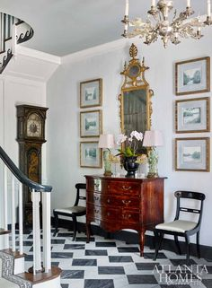 I like the Chinoiserie grandfather clock, lions on the chandelier, klismos chairs, and chest Atlanta Homes and Lifestyles' 2017 Southeastern Designer Showhouse