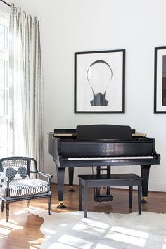 Scandinavian Sensibilities Find a Home in Nashville. ebony baby grand piano.
