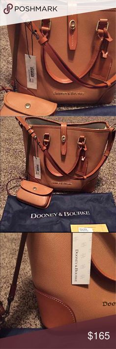 NEW DOONEY & BOURKE SHELBY SHOPPER! New with TAG! retails $298. Has four feet at bottom. Comes with new DOONEY dust bag, detachable matching wristlet, paper registration,tag! Has Tiny unnoticeable water dot on one back bottom corner of bag. tiny faint scratches on each front bottom corners of purse and bottom leather trim of bag. Dooney & Bourke Bags Shoulder Bags