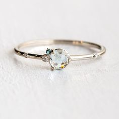 Back by popular demand and now in white gold! Our sky blue topaz Flurry ring is back in stock in 14k white and yellow gold at melaniecasey.com