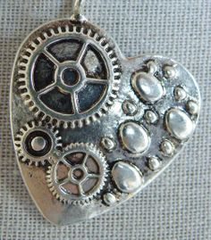 Steampunk Heart Necklace via Hippychick Creations. Click on the image to see more!