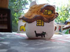 56...these little black cats crop up everywhere on the fairy houses By @gennepher