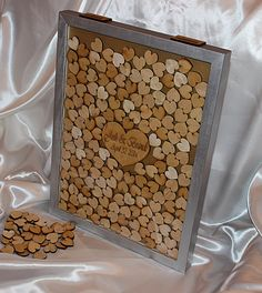 Personalized wooden heart drop box guest book 80, 150 or 200 Hearts to sign.  Guests sign a heart and then drop through one of the post here