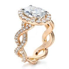 Custom Halo Rose Gold Engagement Ring from Joseph Jewelry. Love it!