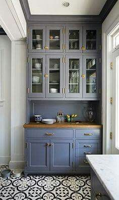 Patterned kitchen floors and blue cabinets