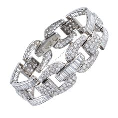 High Glamour: 1950s Round and Baguette Cut Diamond Bracelet | From a unique collection of vintage link bracelets at http://www.1stdibs.com/jewelry/bracelets/link-bracelets/