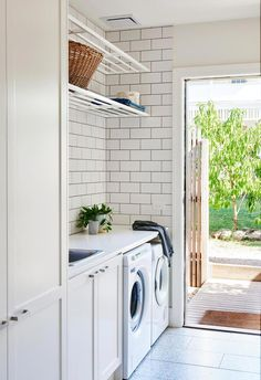 A clever extension refreshed this Californian bungalow Laundry: Having a separate laundry is wonderful, says Kristen, who finds the floating shelves above the bench particularly useful for storage. Small Laundry, Laundry In Bathroom, Laundry In Kitchen, Laundry Closet, Bungalow Bathroom, Modern Laundry Rooms, Kitchen Reno, Bungalow Renovation, Renovation Budget
