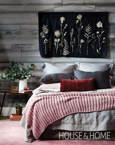 Leave it to H&H's assistant design editor Jen Koper to craft the perfect wall hanging for this bedroom. To complete the cabin feel, Jen layered the bed with cozy linens and added wood wall paneling behind. | Photographer: Donna Griffith | Designer: Jen Koper