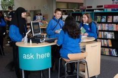 """Djanogly City Academy - library design (love the small """"ask here"""" staff pod--would this work for us?)"""