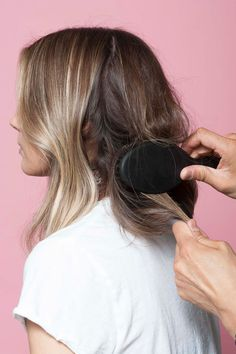 Next, back brush your hair to give the strands more grip. Use a light touch and work slowly to avoid knots and snarls.