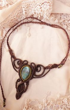 Handmade macrame necklace with labradorite gemstone. Made from a natural labradorite full of orange, blue, and white flases, metallic beads,