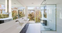 This Gatineau Hills home designed by Christopher Simmonds Architect, finds a beautiful balance between modern and natural in Cantley, Québec, Canada. Luxury Master Bathrooms, Modern Master Bathroom, Small Bathroom, Modern Bathrooms, Melbourne, Modern Sink, Sliding Patio Doors, Diy Bathroom Decor, Bathroom Ideas