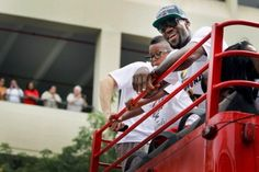 Lebron James of the Miami Heat rides in a victory parade through the streets during a celebration for the 2012 NBA Champion Miami Heat on June 25, 2012 in Miami, Florida. The Heat beat the Oklahoma Thunder to win the NBA title.