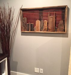 "Reclaimed Nashville Framed Skyline. Constructed of 75+ year old Barn Wood and Barn Metal roofing. Dimensions: 43"" Long X 23"" Wide X 2.5"" Thick - $197"