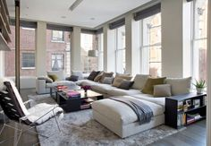 White sectional in a modern loft 10 Rooms Featuring Modern Sectional Sofas Living Room Interior, Home Living Room, Living Room Designs, Living Room Decor, Living Area, New York Loft, Ny Loft, White Sectional, Modern Sectional