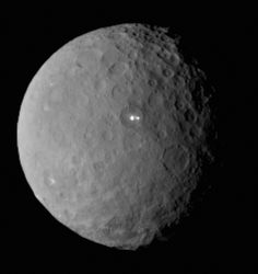 Ceres. Image taken by NASA's Dawn spacecraft of the dwarf planet on Feb. 19 from a distance of nearly 29,000 miles (46,000 km). It shows that the brightest spot on Ceres has a dimmer companion, which apparently lies in the same basin. (Credit: NASA/JPL-Caltech/UCLA/MPS/DLR/IDA)
