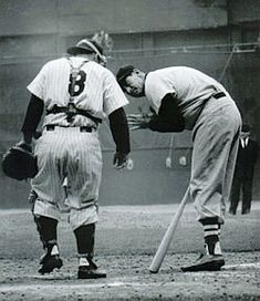 Yogi Bera, No. 8, having a few words with Boston Red Sox great, Ted Williams.